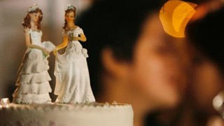 Gay-marriage--brides-on-wedding-cake-jpg_1354913710937.jpeg