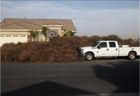 Weather damage, tumbleweeds take over home