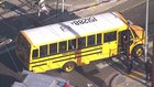 Railroad crossing arm goes through LA school bus