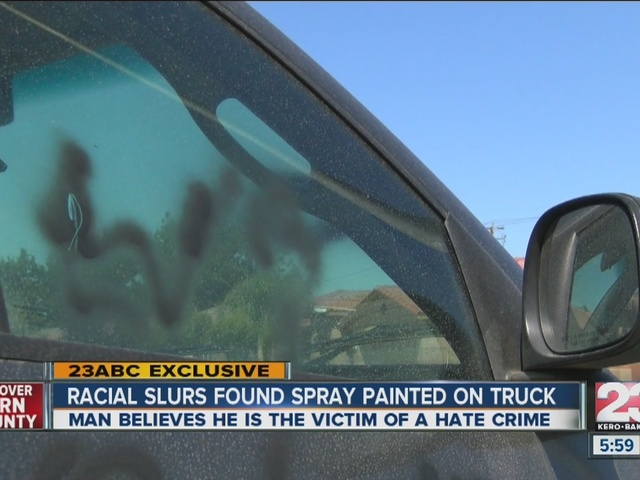 Man finds car covered in derogatory words and symbols