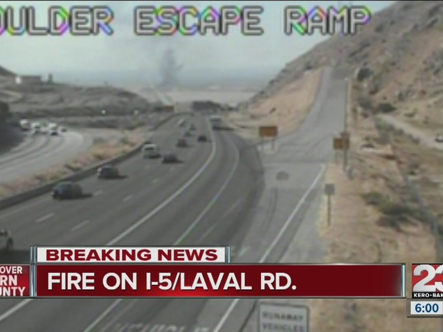 Big rig fire slows traffic on I-5, sparks grass fire