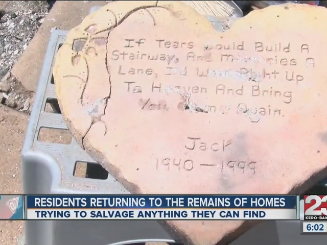 Residents returning to remains of homes