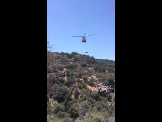 KCFD use rescue helicopter to hoist man up after he fell and rolled down slope