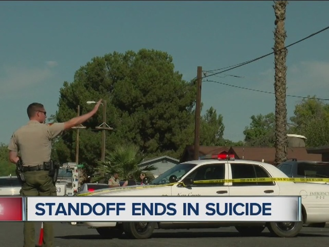 Neighborhood trying to move on from standoff and murder