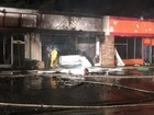 Truck crashes into building, catches fire