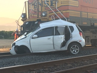 Train hits unoccupied car near Highway 58