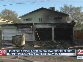 Child arrested after fire leaves 15 homeless