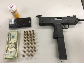 BPD finds man passed out in car, gun on chest