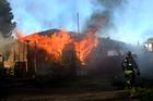 Taft home fire injures woman