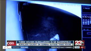 Burglars caught on camera outside third house