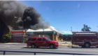Strip mall catches fire in Central Bakersfield