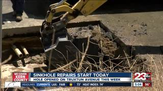 City crews work to repair a sinkhole