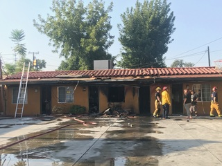 Motel fire displaces 32 people 8 dogs dead