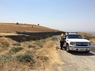 Brush fire on Highway 223 near Keene