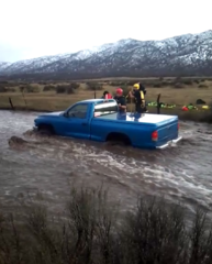 VIDEO: Couple rescued from flash flood
