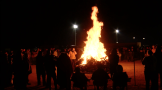 Ridgecrest hosts bonfire for Burroughs HS fball