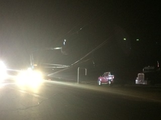 Vehicle hits power pole, live wires in roadway