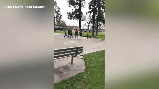 Bakersfield police officer shoots hoops with kids at local park