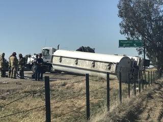 Semi rollover causes traffic delays on 99