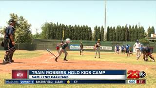 Kids play ball with Bakersfield Train Robbers