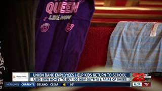 Local bank employees get kids excited for...