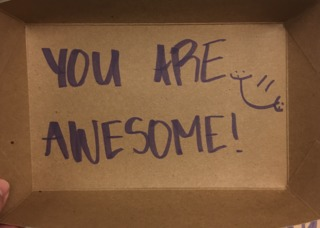 Cafeteria manager adds happy notes to food trays