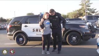 Officers escort fallen deputy's sister to school